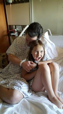 """My daughter's """"crazy face smile."""" This would be the last time I would see her before my surgery. We watched the first episode of Avatar: The Last Airbender together."""
