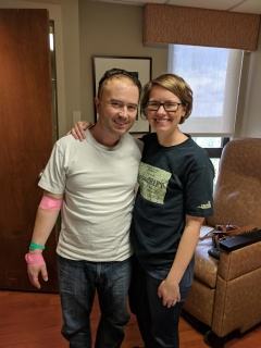 Picture of me and my wife finally leaving the hospital after a nine day stay.