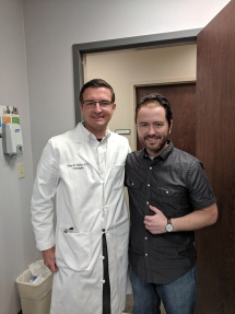 A picture of me and the neurosurgeon who gave me my resurrected life. Also my superhero brother.